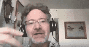 Adam Tooze in headphones speaking
