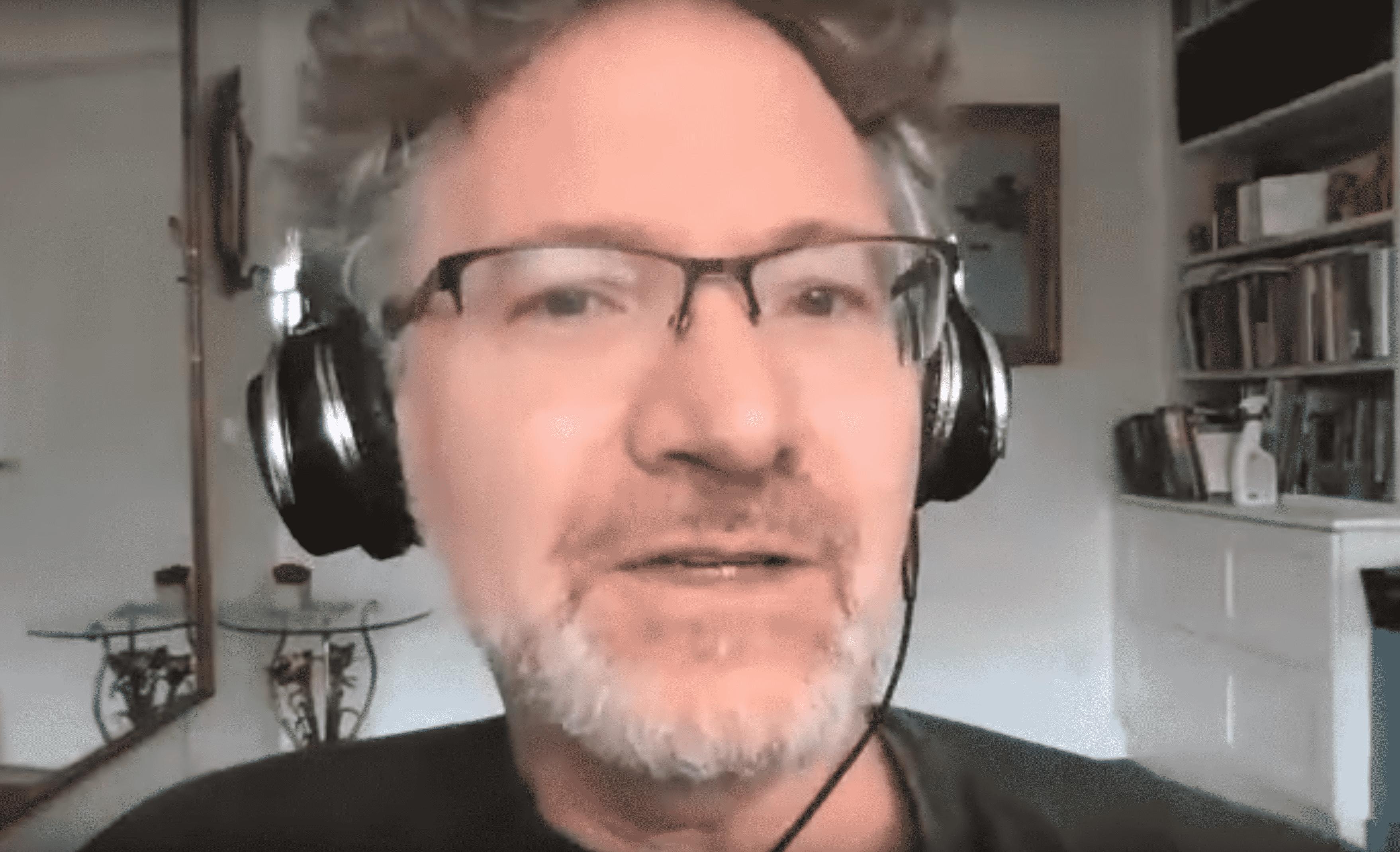 Adam Tooze speaking with headphones on
